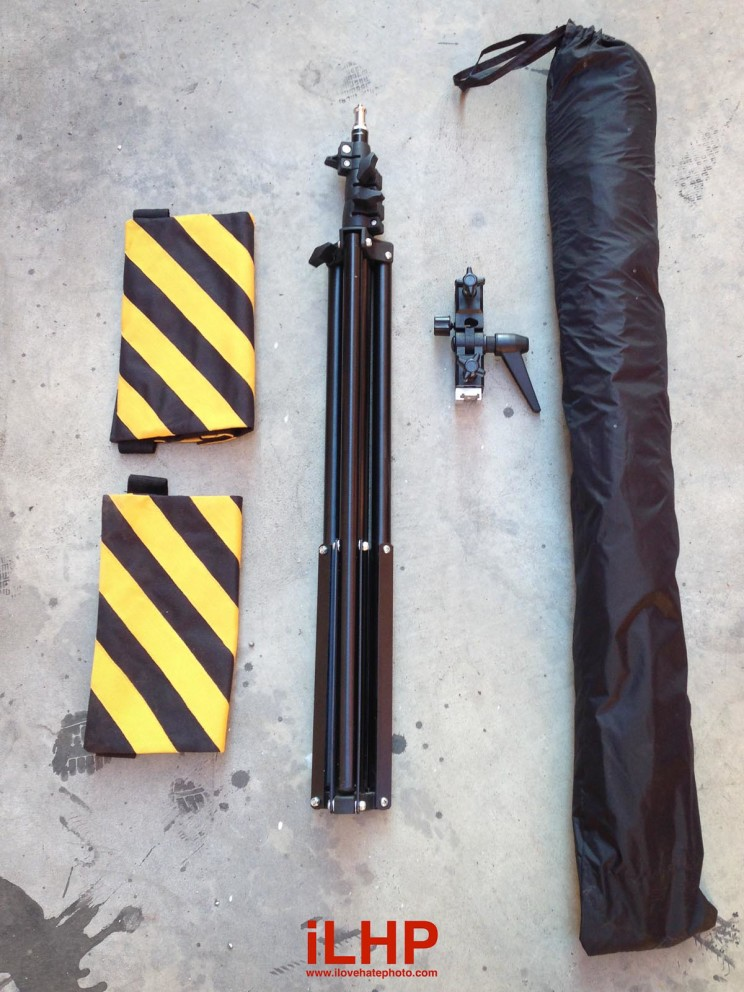 From left to right: Sandbags, light stand, mount, and the Softlighter II in its carrying bag