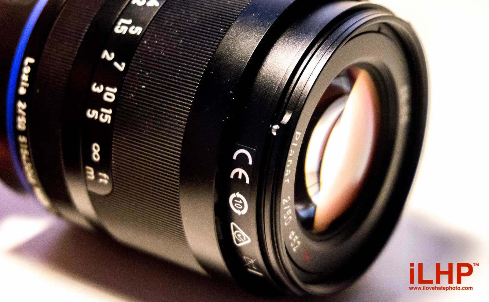 Most twist-on lens hoods have a plastic notch cut into the barrel that holds the hood in place after you rotate it past a certain point. Presuming that plastic can be worn down over time, Zeiss has replaced it with a tiny metal ball bearing. This is fastidious attention to detail.