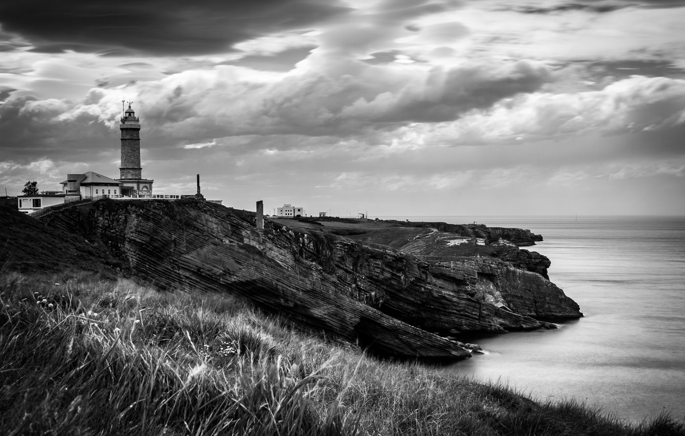 The lighthouse in Santander, Spain. I made a promise to myself that I would always practice my long exposure daytime photography when travelling. The second to last day of the conference I hired bicycles with my colleagues to go out in the afternoon and have a look at the lighthouse, a joy for photographers. I went back to the hotel that evening, copied my photos from the camera to the laptop and erased the card (rookie mistake: never travel with less than 2 cards regardless of their size). Two days later my laptop died while still in Spain and recovery utilities on a colleague's laptop could recover this single image from that day. A single image!